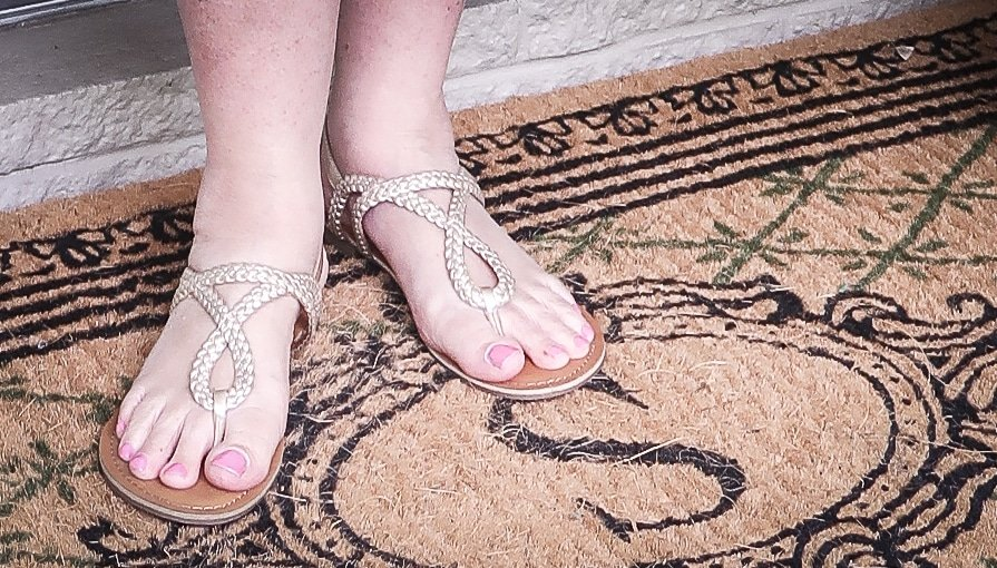 Fashion Blogger 50 Is Not Old is wearing gold braided sandals from Target