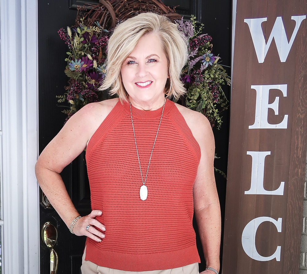 Fashion Blogger 50 Is Not Old is wearing a red clay crochet halter top and gold jewelry