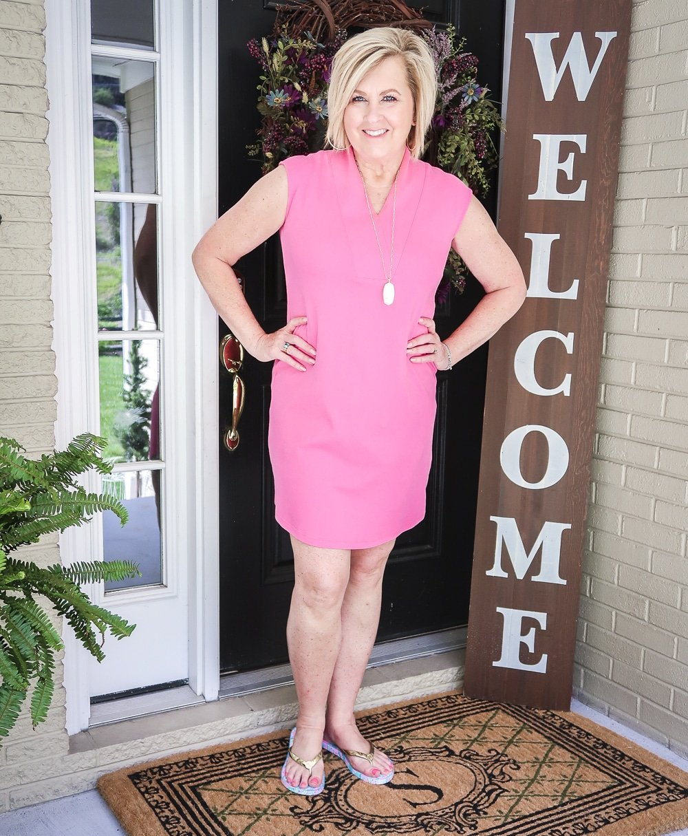 Fashion Blogger 50 Is Not Old is wearing a comfortable pink dress from Isaac Mizrahi with Lilly Pulitzer flip flops