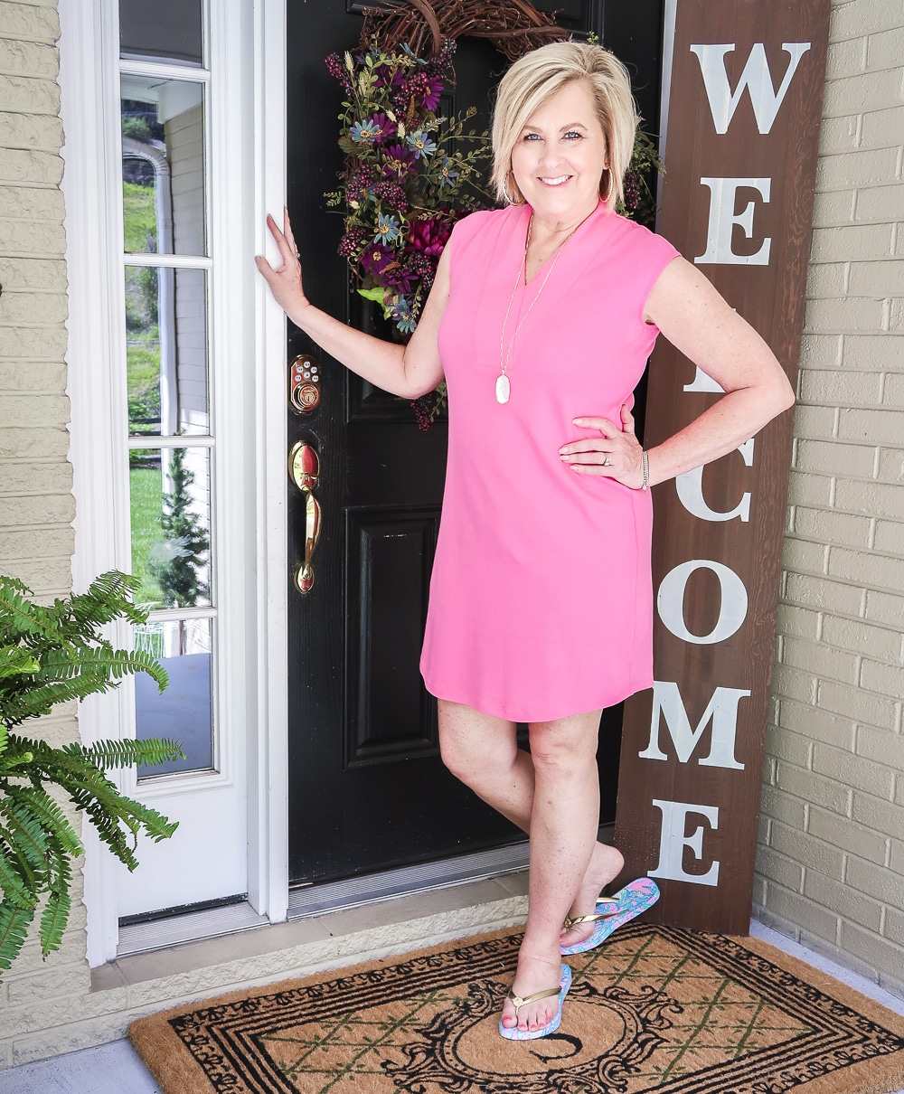 Fashion Blogger 50 Is Not Old wearing a pink sheath dress from Isaac Mizrahi with Lilly Pulitzer flip flops