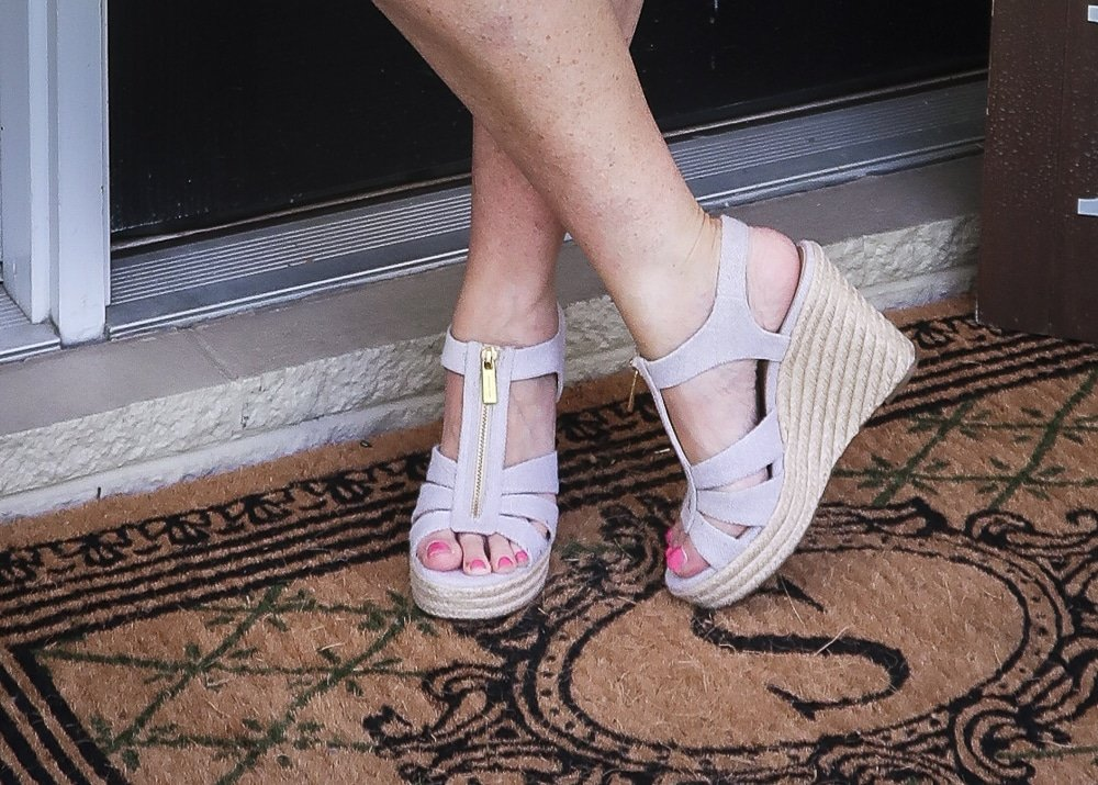 Fashion Blogger 50 Is Not Old wearing a platform espadrille wedge shoes by Micheal Kors