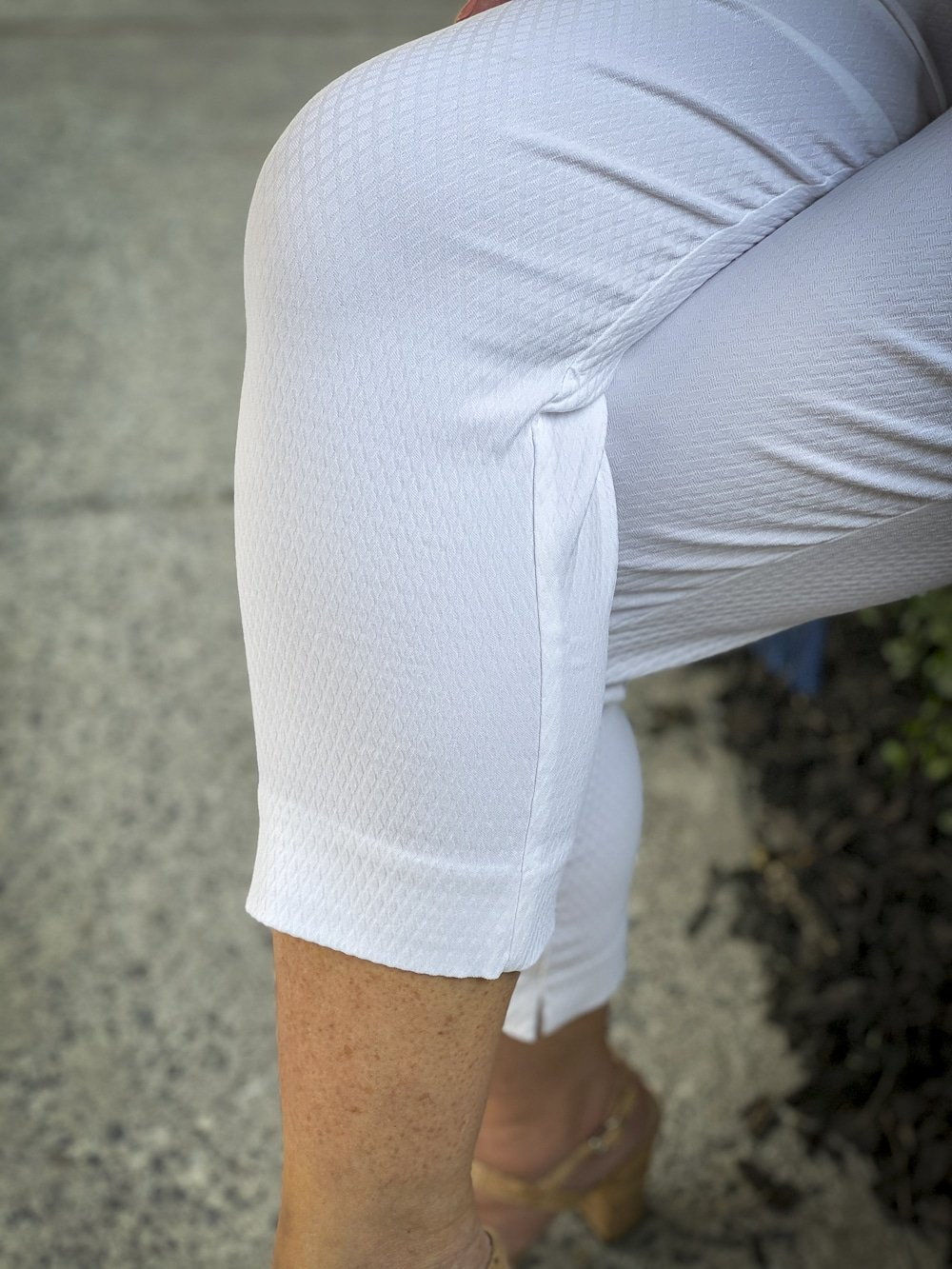 Fashion Blogger 50 Is Not Old is wearing white textured crop pants from Chicos and bamboo heels