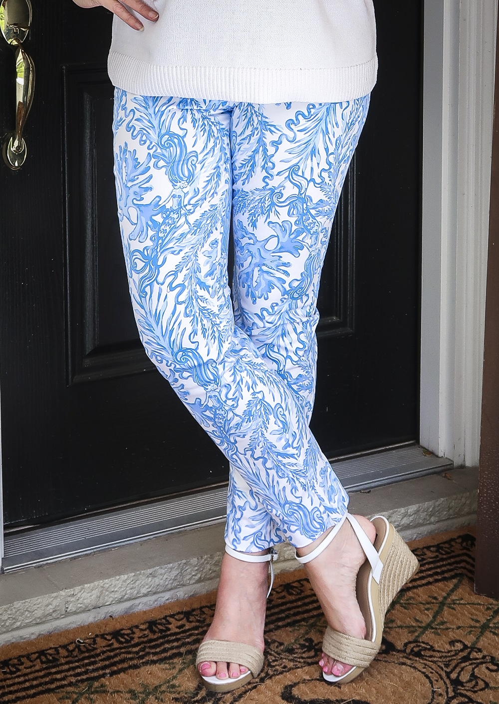 Fashion Blogger 50 Is Not Old is wearing a classic blue and white outfit. Blue and white printed ankle pants from Lilly Pulitzer and espadrille wedges