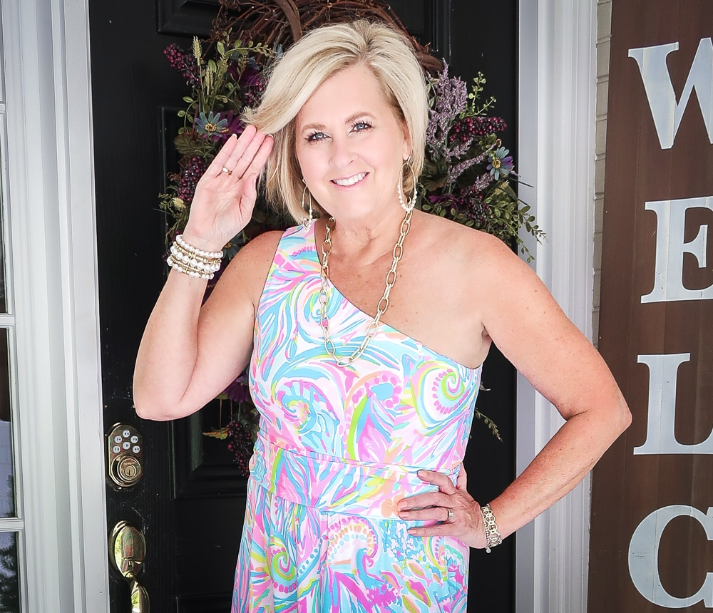 Fashion Blogger 50 Is Not Old is styling a one shoulder Lilly Pulitzer maxi with gold jewelry from Kendra Scott