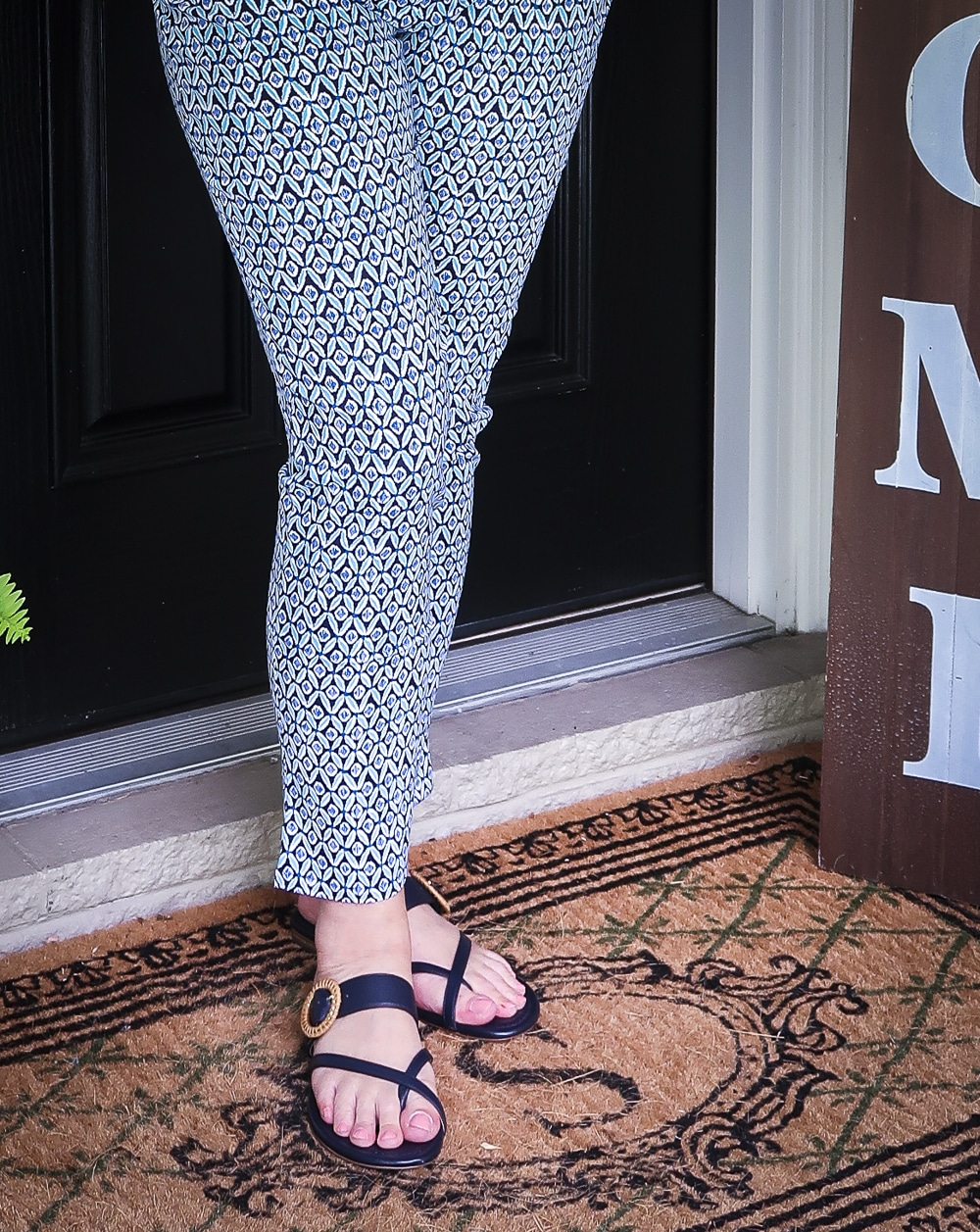 Fashion Blogger 50 Is Not Old wearing printed ankle pants with navy sandals