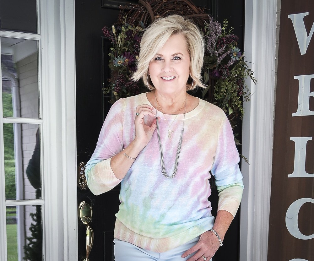Fashion Blogger 50 Is Not Old is wearing a gorgeous tie-dye sweater with silver jewelry