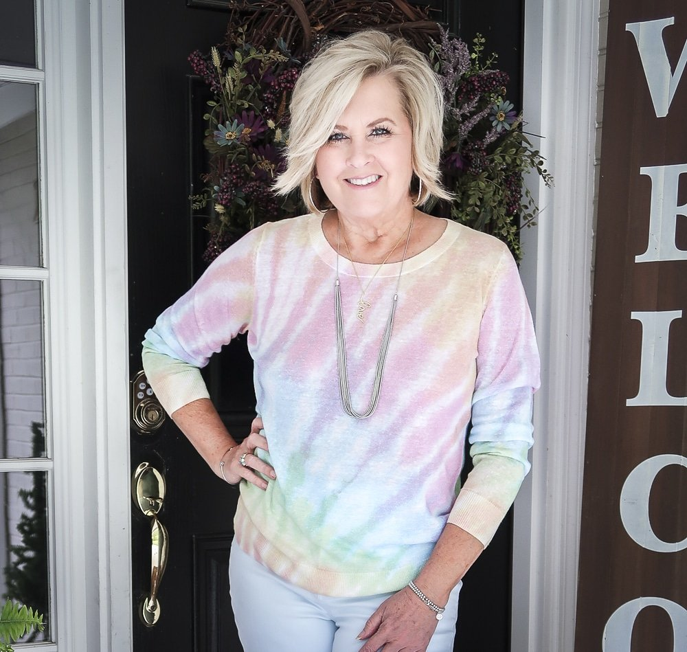 Fashion Blogger 50 Is Not Old is wearing a tie-dye sweater