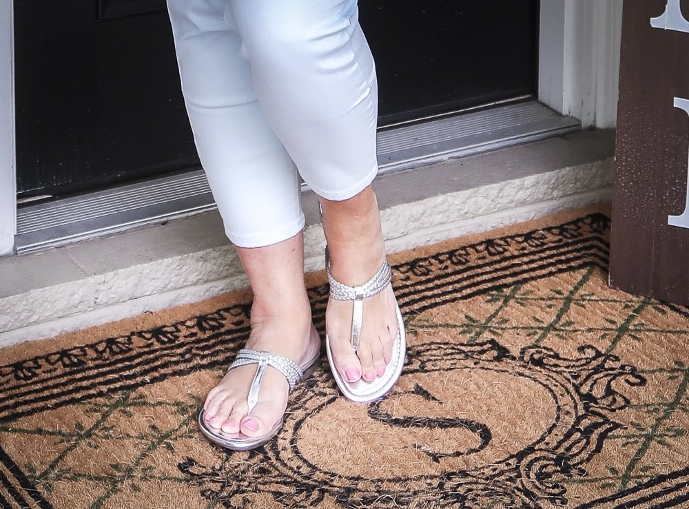 Fashion Blogger 50 Is Not Old is wearing silver braided sandals