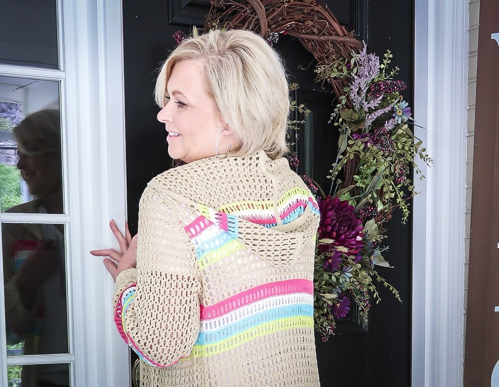 Fashion Blogger 50 Is Not Old is showing the back of an open knit long cardigan