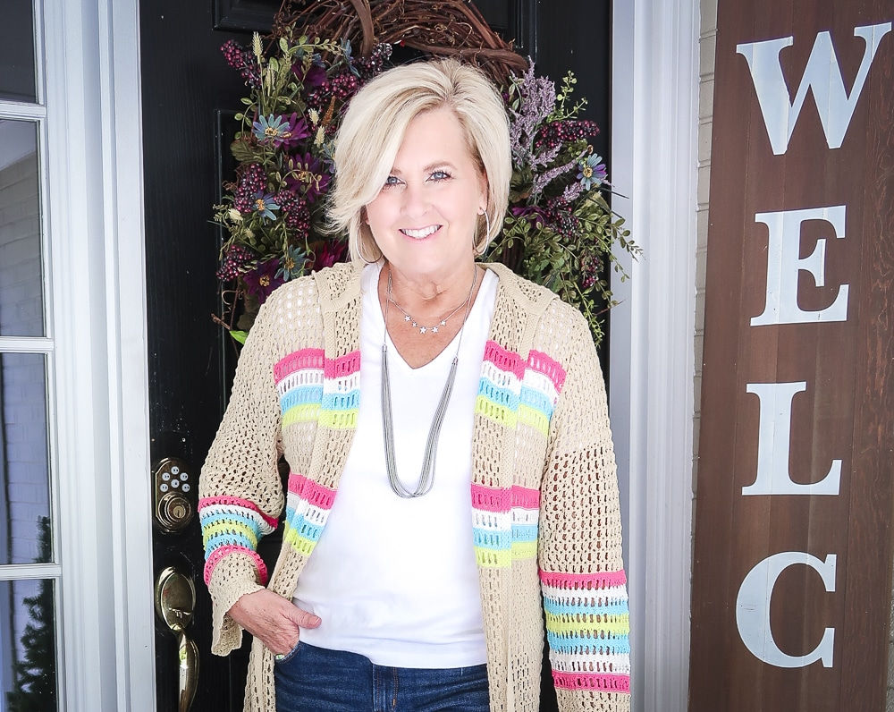 Fashion Blogger 50 Is Not Old is wearing a white v neck t-shirt and a open knit long cardigan
