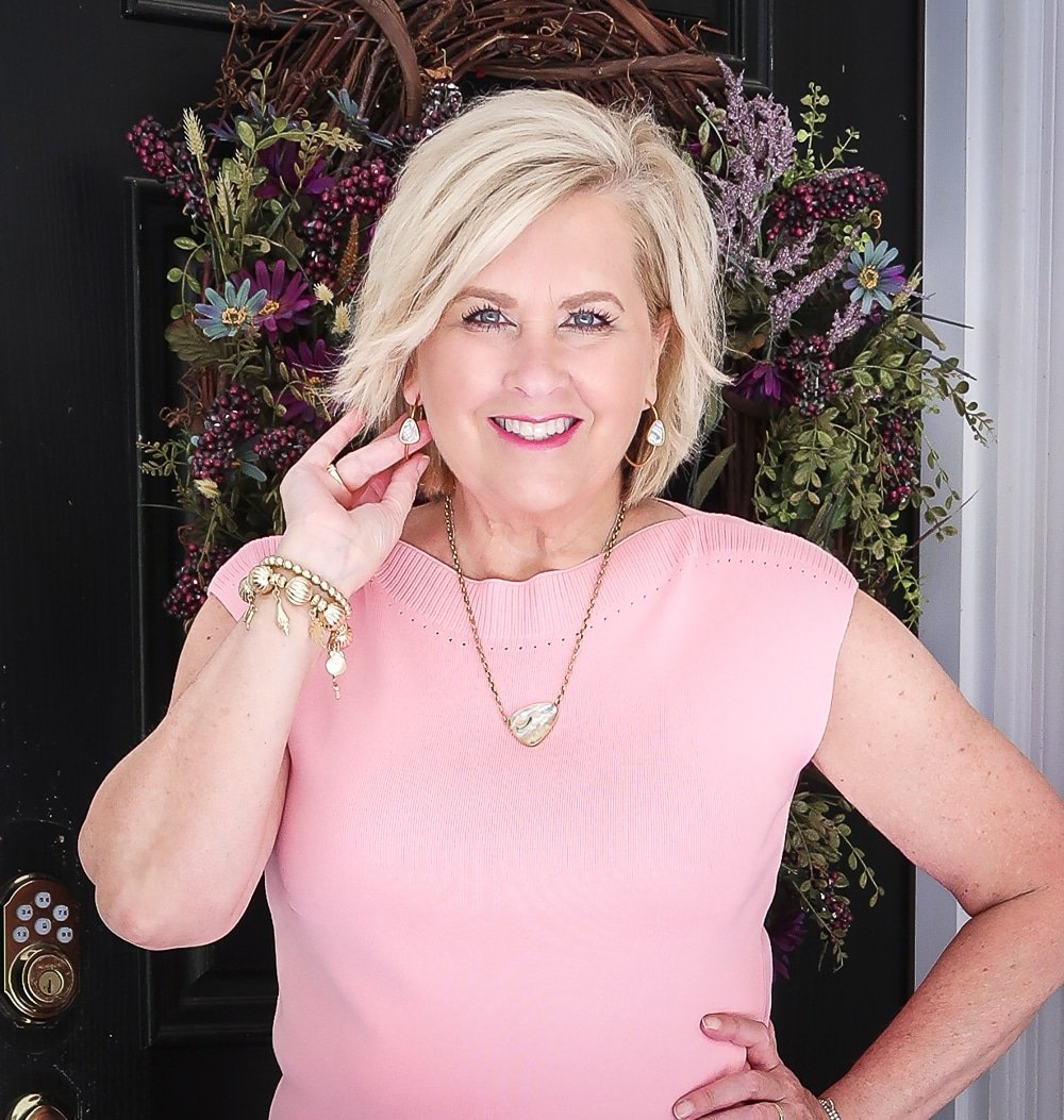 Fashion Blogger 50 Is Not Old is showing off her gold Kendra Scott jewelry