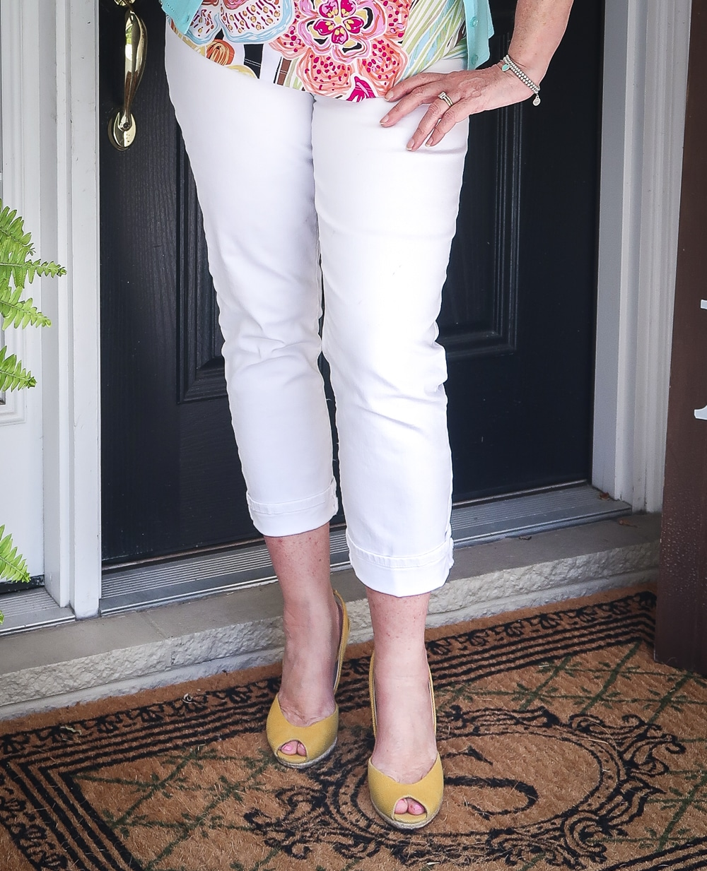 Fashion Blogger 50 Is Not Old is looking summery in white ankle jeans and yellow espadrilles