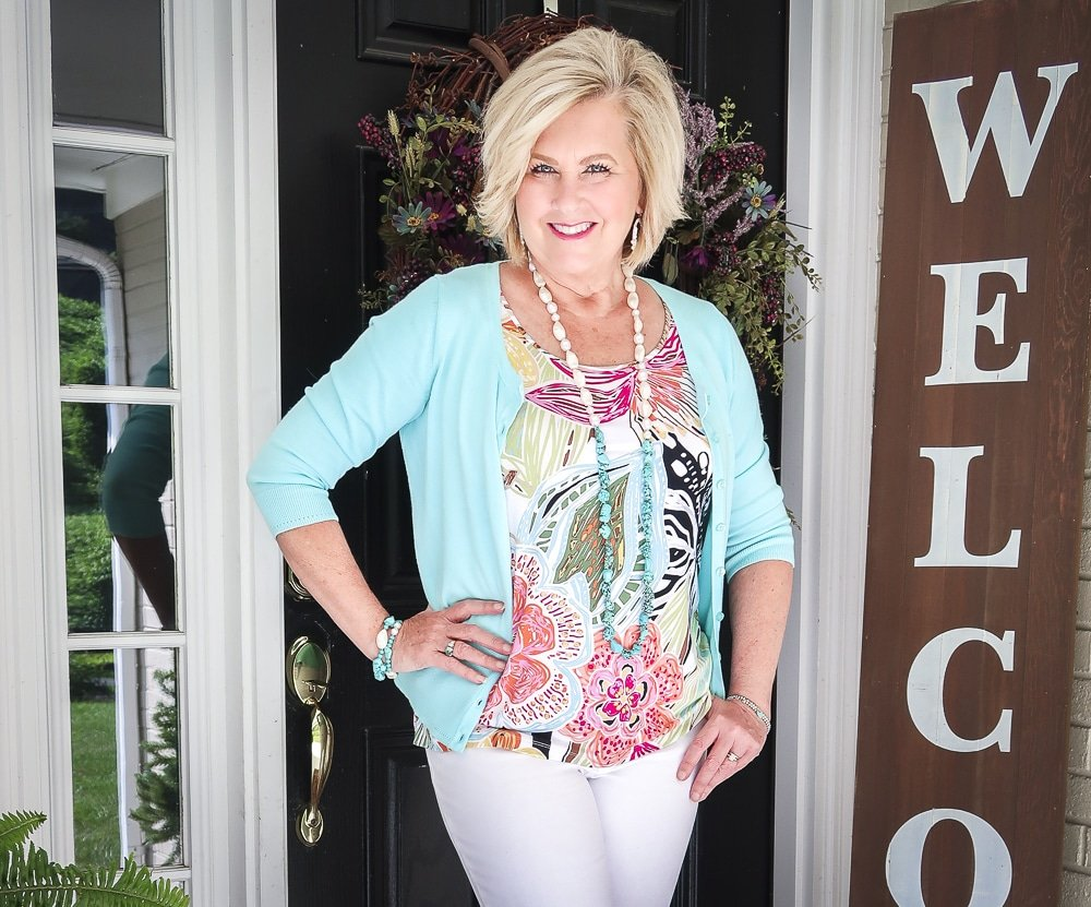 Fashion Blogger 50 Is Not Old is looking summery in an aqua cardigan and a bright tropical top