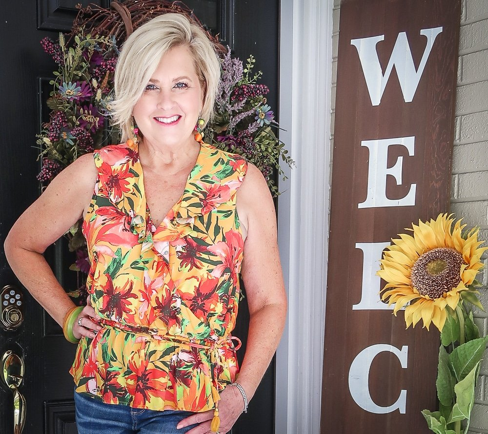 Fashion Blogger 50 Is Not Old is wearing a tropical ruffled peplum top