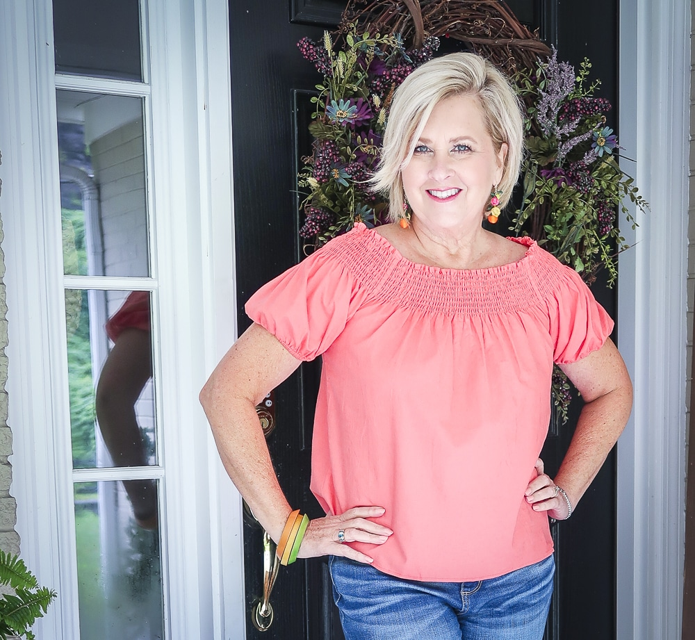 Fashion Blogger 50 Is Not Old is wearing off the shoulder coral top from Walmart