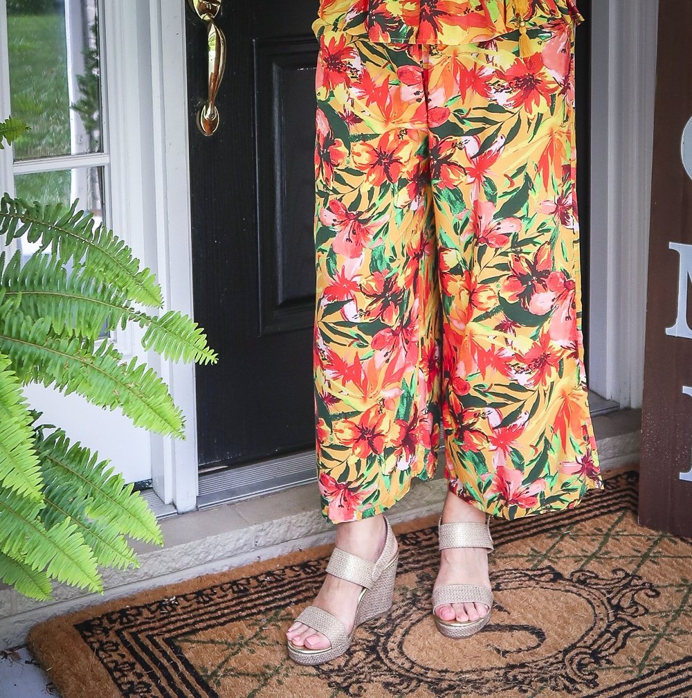Fashion Blogger 50 Is Not Old is wearing a tropical pair of crop pants and a pair of gold espadrille wedges