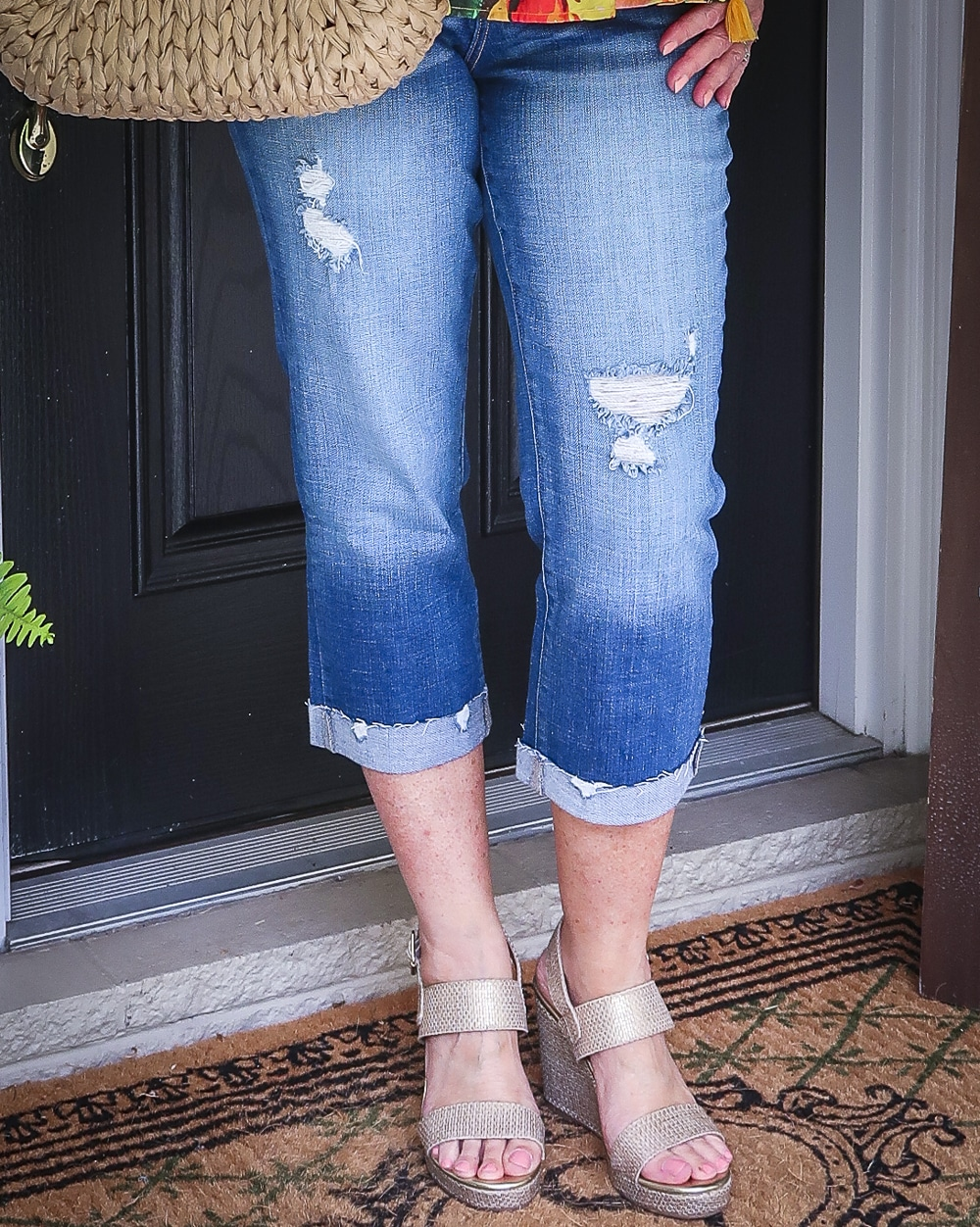 Fashion Blogger 50 Is Not Old is wearing a pair of distressed crop jeans with gold espadrille wedges from Walmart