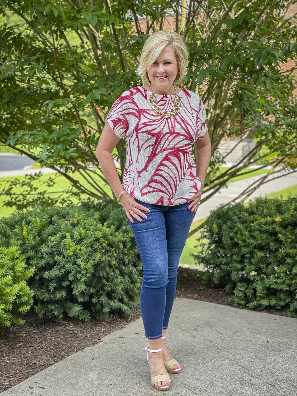 Fashion Blogger 50 Is Not Old is looking tropical in her red and white tropical leaf print sweater and skinny ankle jeans from Chico's