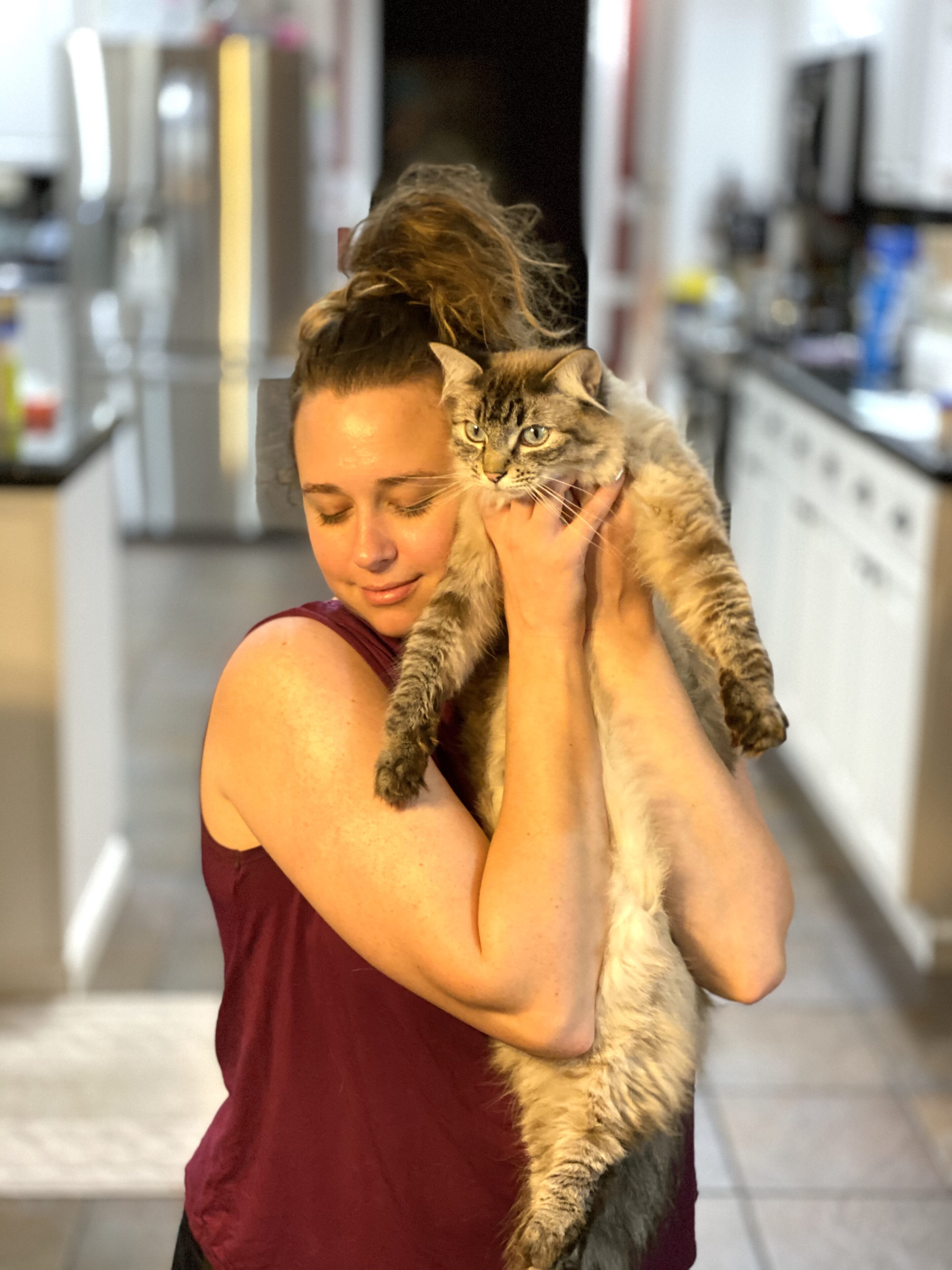 Fashion Blogger 50 Is Not Old's daughter with her cat, Thomas