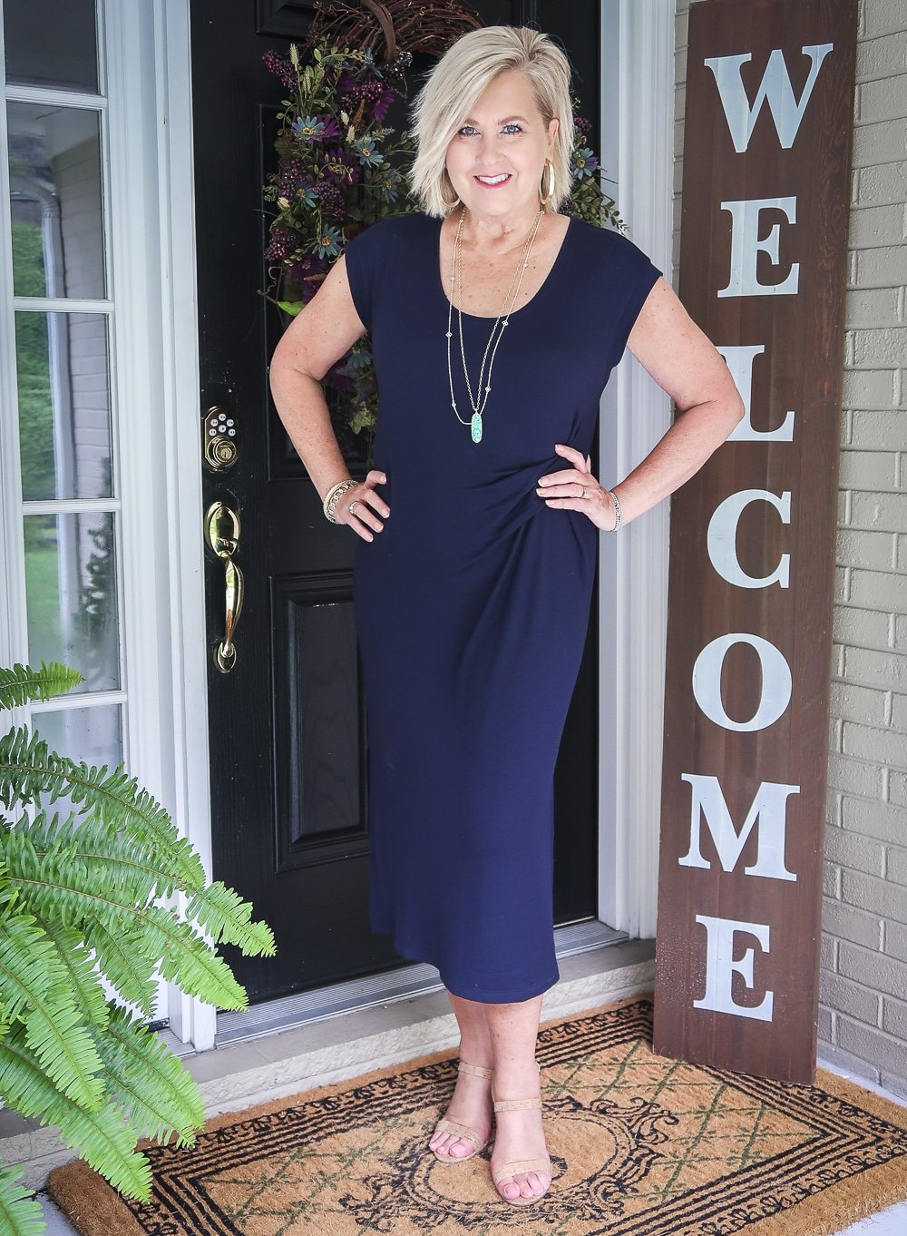 Fashion Blogger 50 Is Not Old is wearing a navy scoop neck midi dress with cork heels