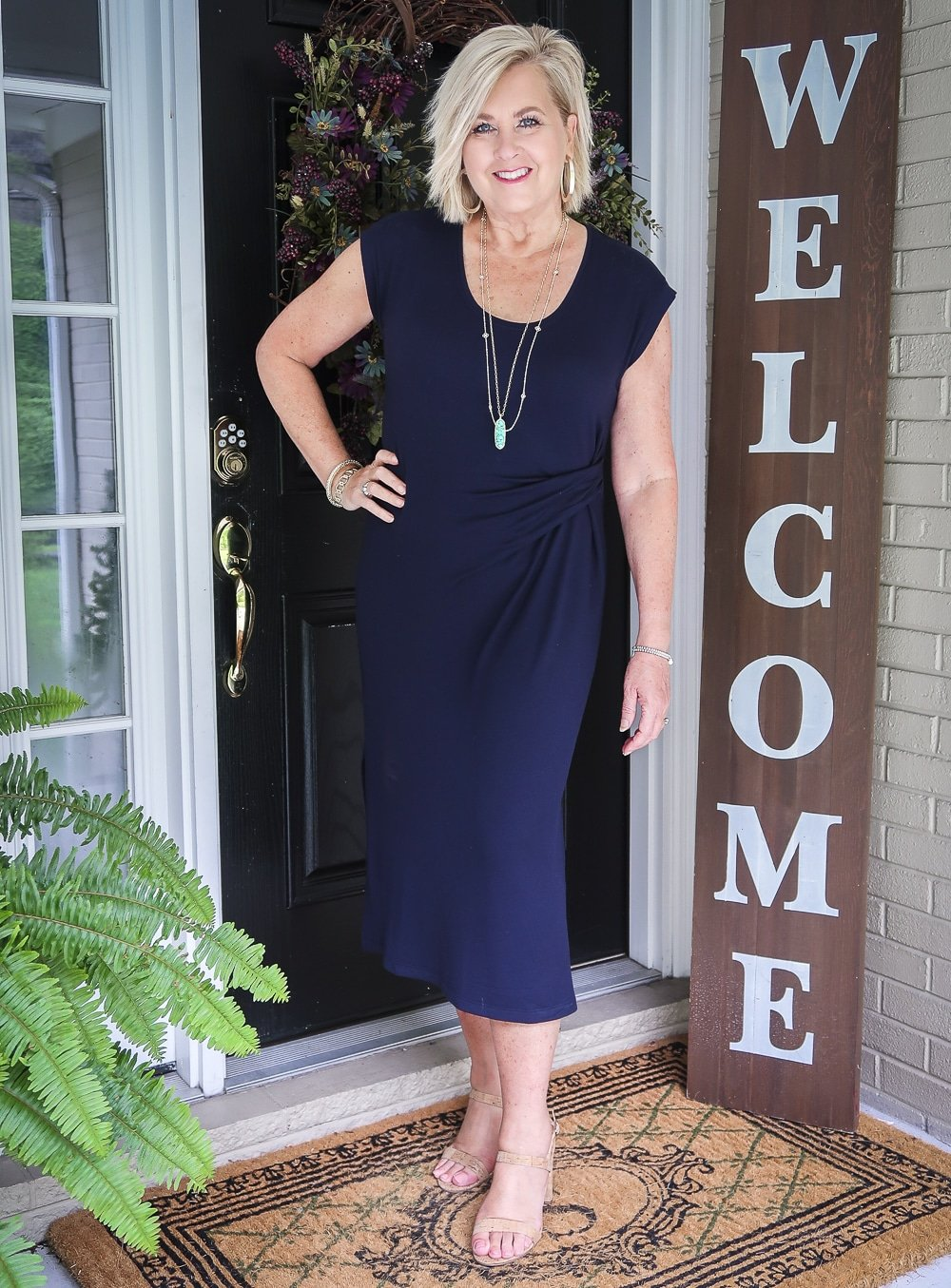 Fashion Blogger 50 Is Not Old is wearing a navy scoop neck midi dress by Lou & Grey with cork heels