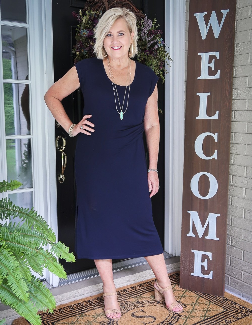 Fashion Blogger 50 Is Not Old is wearing a navy midi dress with cork heels