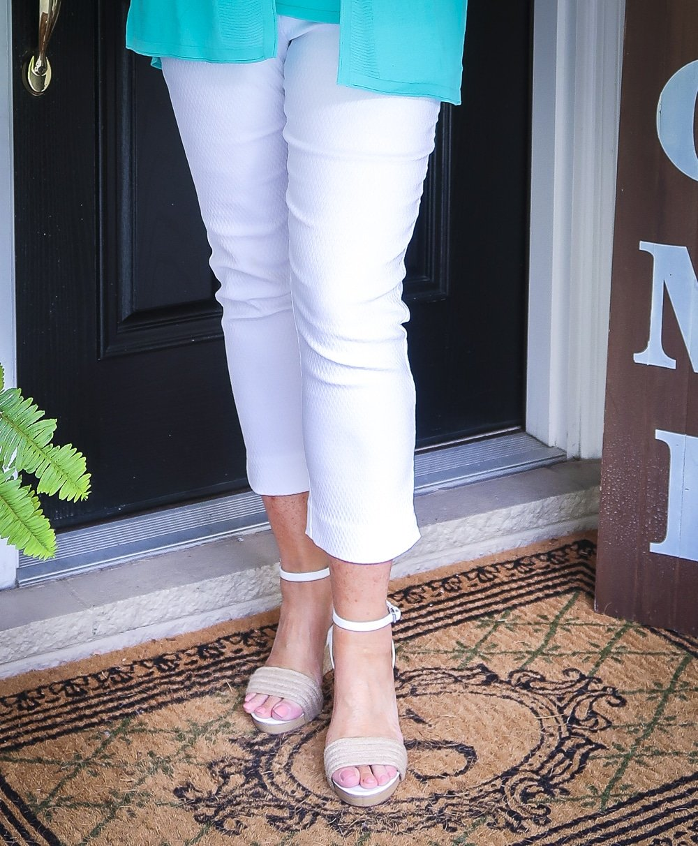 Fashion Blogger 50 Is Not Old is wearing a pair of white espadrilles and white crop pants from Chicos