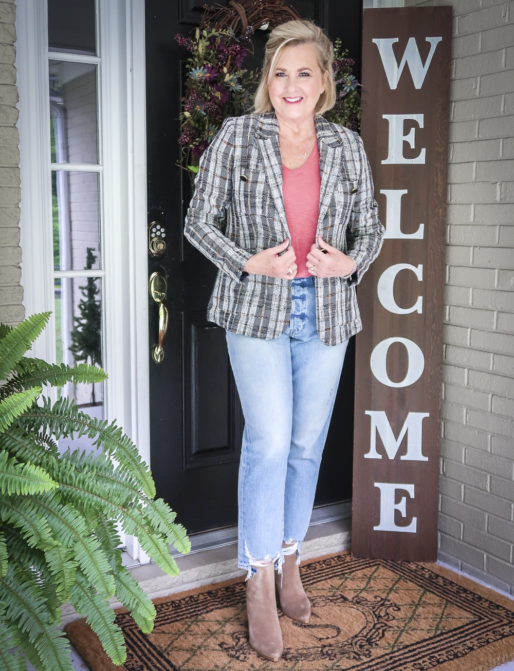 Fashion Blogger 50 Is Not Old is wearing a tweed blazer and distressed jeans