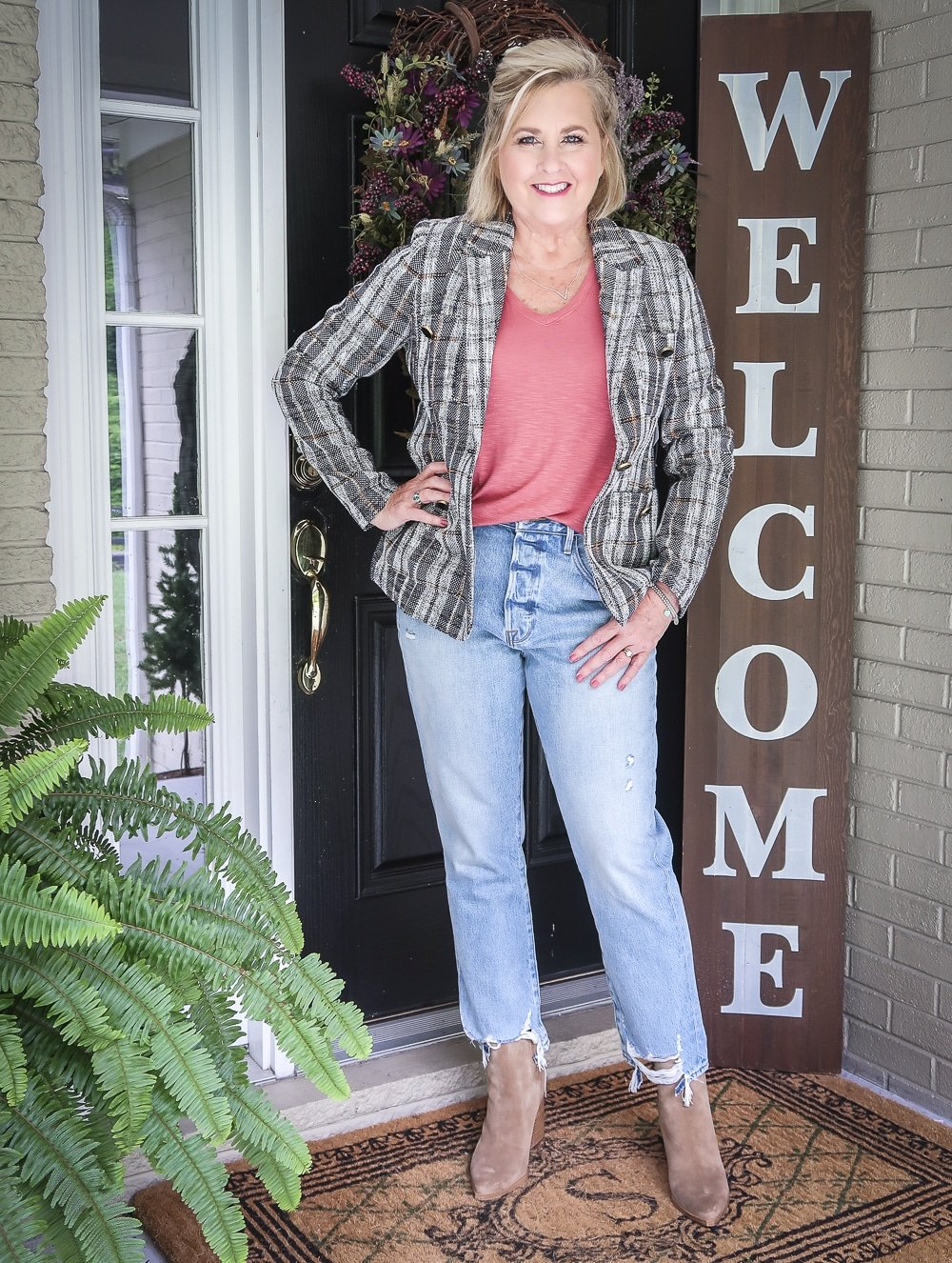Fashion Blogger 50 Is Not Old in a tweed jacket, raw hem jeans, and ankle boots