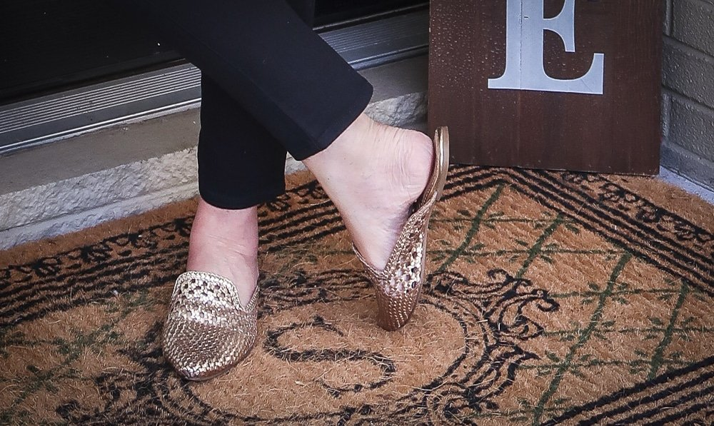 Fashion Blogger 50 Is Not Old is wearing gold mules
