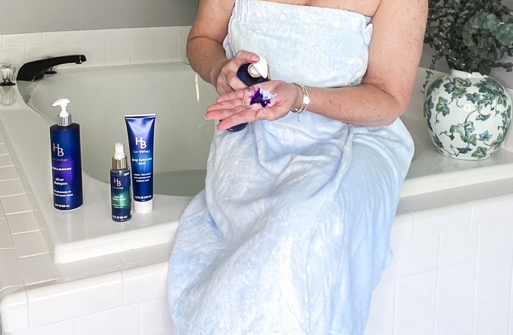 Fashion Blogger 50 Is Not Old is using the purple shampoo and conditioner from Hair Biology
