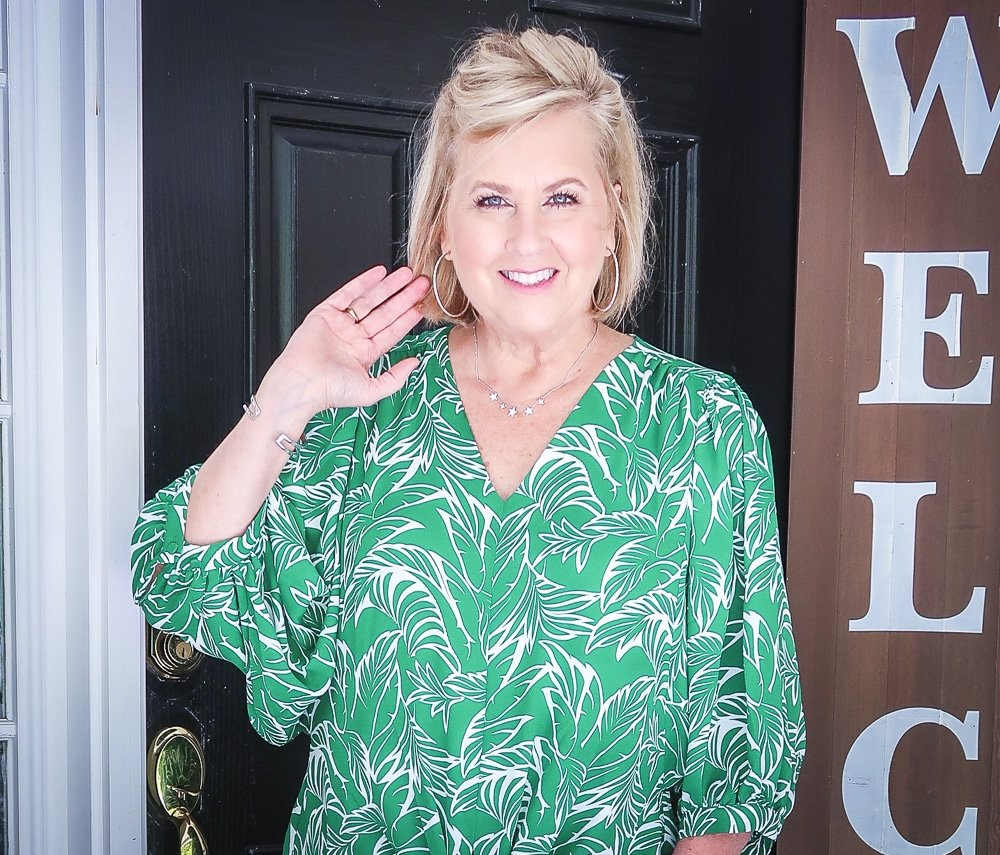 Fashion Blogger 50 Is Not Old is wearing a green palm print blouse and silver jewelry