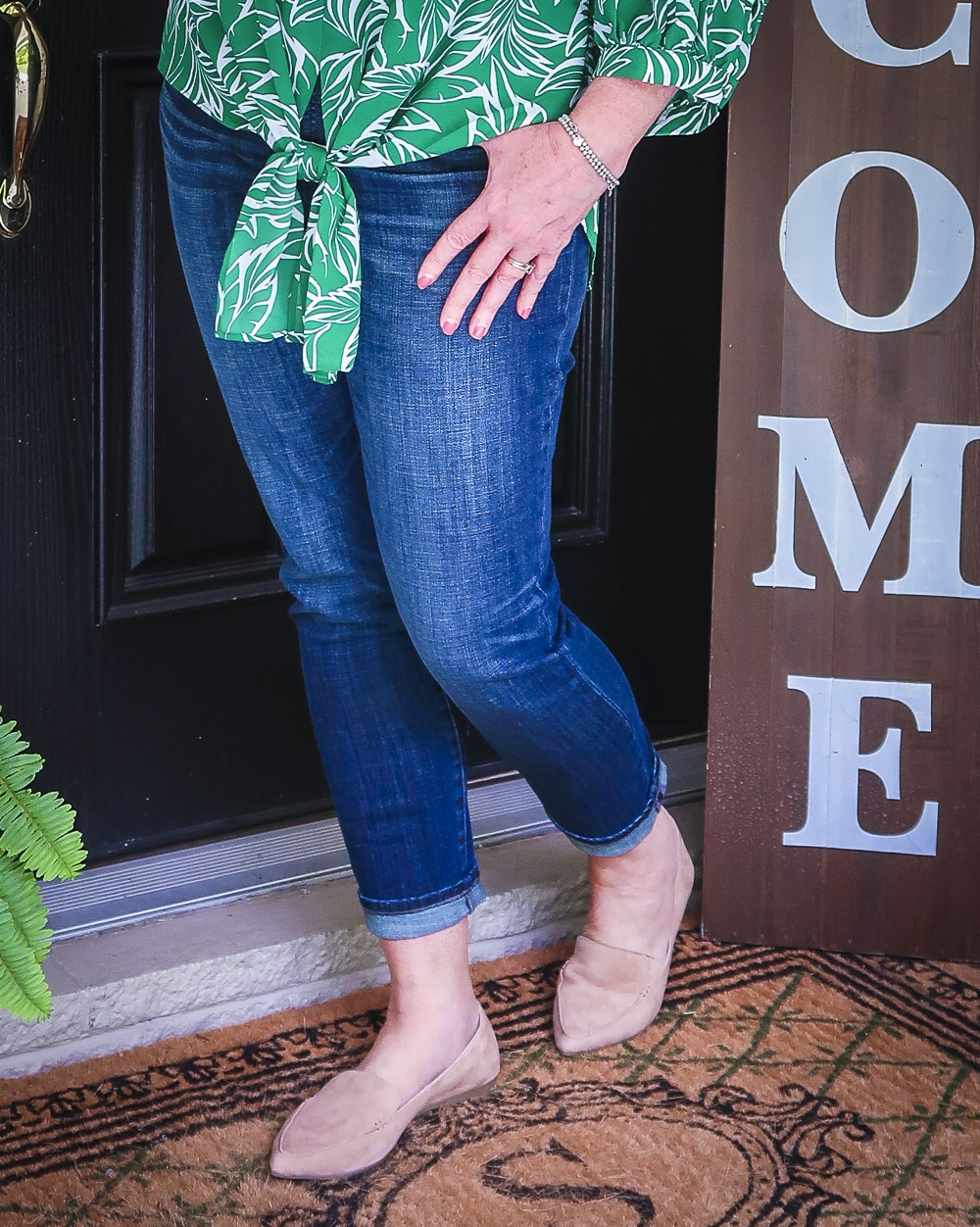 Fashion Blogger 50 Is Not Old is wearing dark indigo girlfriend jeans with camel loafers