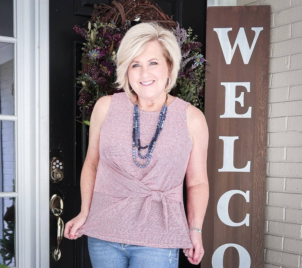 Fashion Blogger 50 Is Not Old is ready for Labor Day in her red white and blue top twist top
