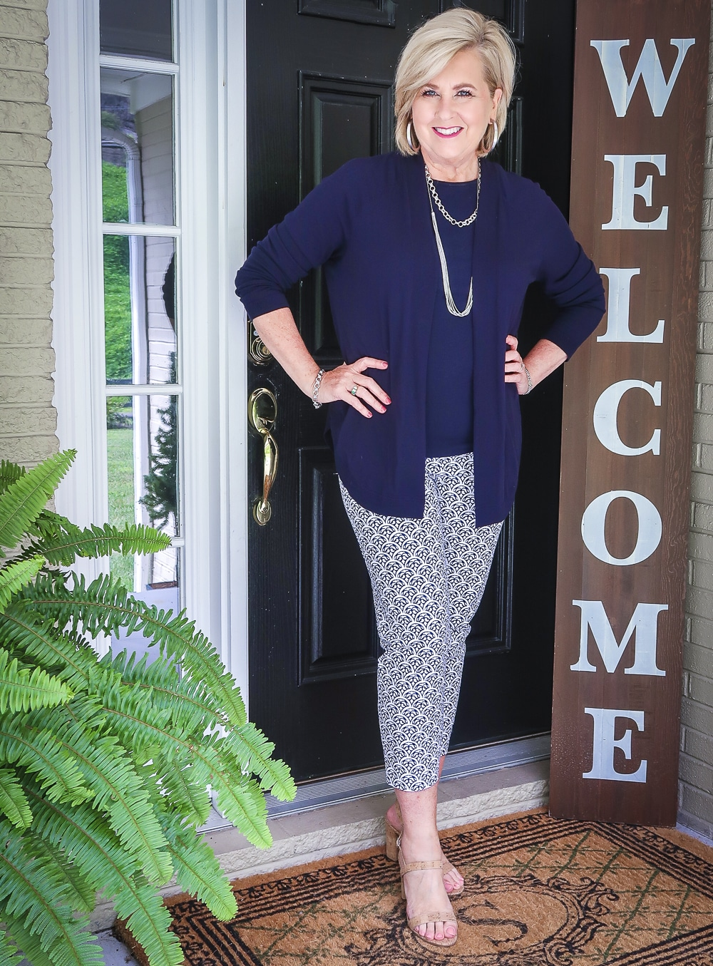 Fashion Blogger 50 Is Not Old is wearing a navy cardigan from Talbots with a navy tank top and blue and white ankle pants