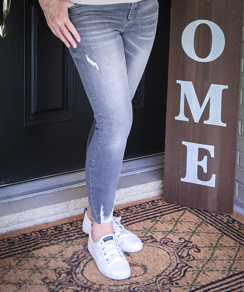 Fashion Blogger 50 Is Not Old is wearing a pair of washed gray jeans from Kut From The Kloth with Sperry Crest Vibe sneakers