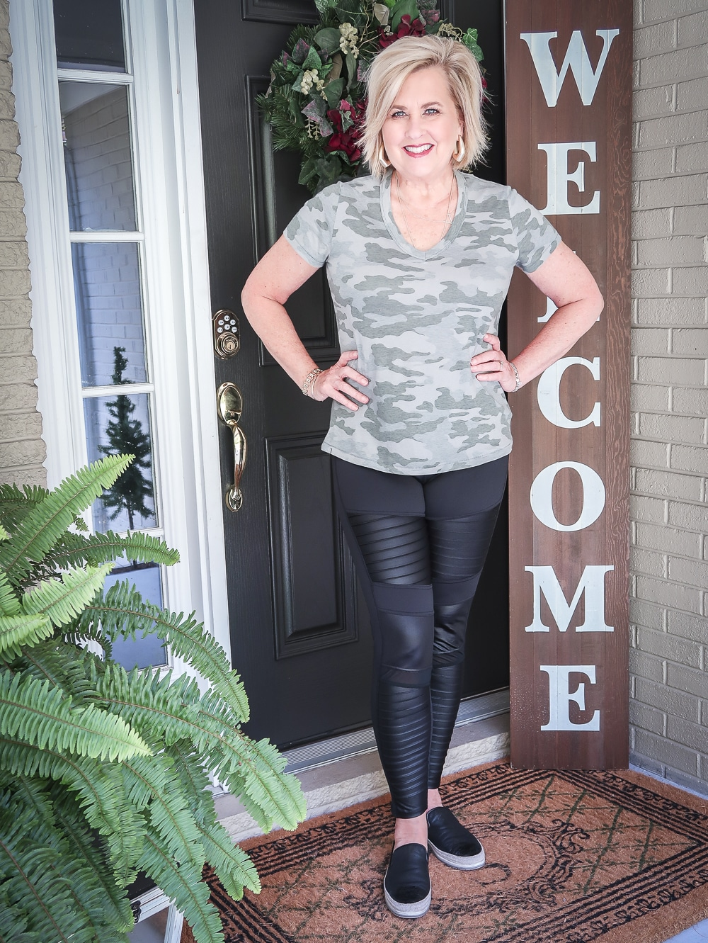 Fashion Blogger 50 Is Not Old is doing a Tuesday Try-On Session with Target and styling a camo v-neck tee shirt with black moto leggings