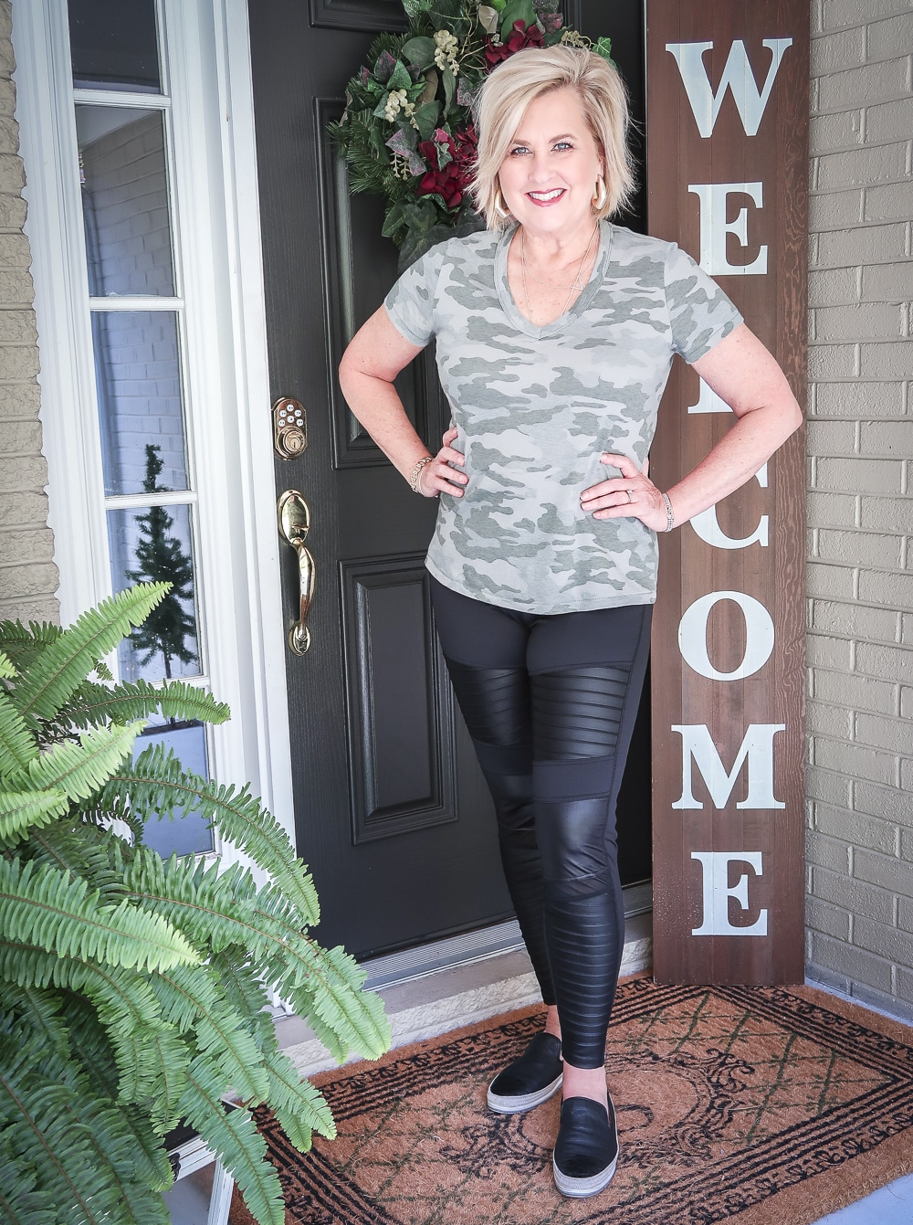 Fashion Blogger 50 Is Not Old is doing a Tuesday Try-On Session with Target and styling a camo v-neck tee shirt and black moto leggings