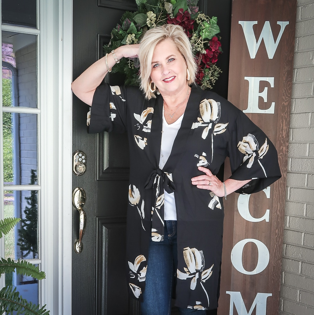 Fashion Blogger 50 Is Not Old is doing a Tuesday Try-On Session with Target and styling a black floral kimono and a white v-neck tee shirt