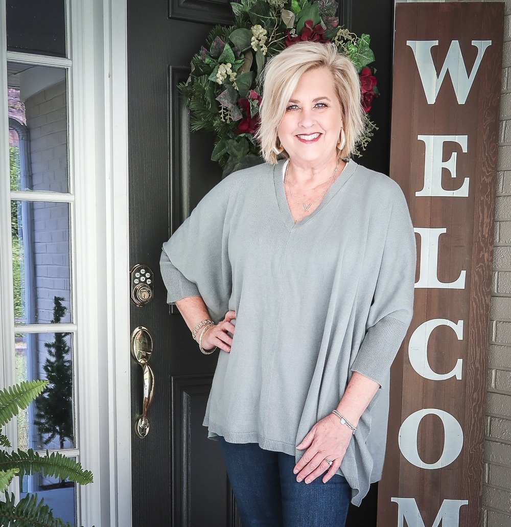 Fashion Blogger 50 Is Not Old is doing a Tuesday Try-On Session with Target and styling a marble green poncho and a white v-neck tee shirt