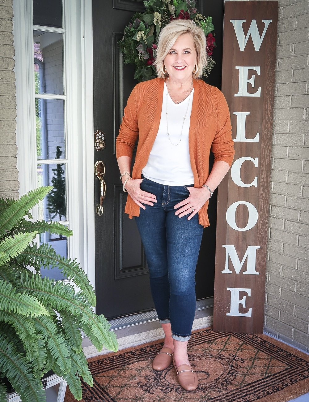 Fashion Blogger 50 Is Not Old is doing a Tuesday Try-On Session with Target and styling a rust cardigan, a white v-neck tee shirt, and dark jeans from Chico's