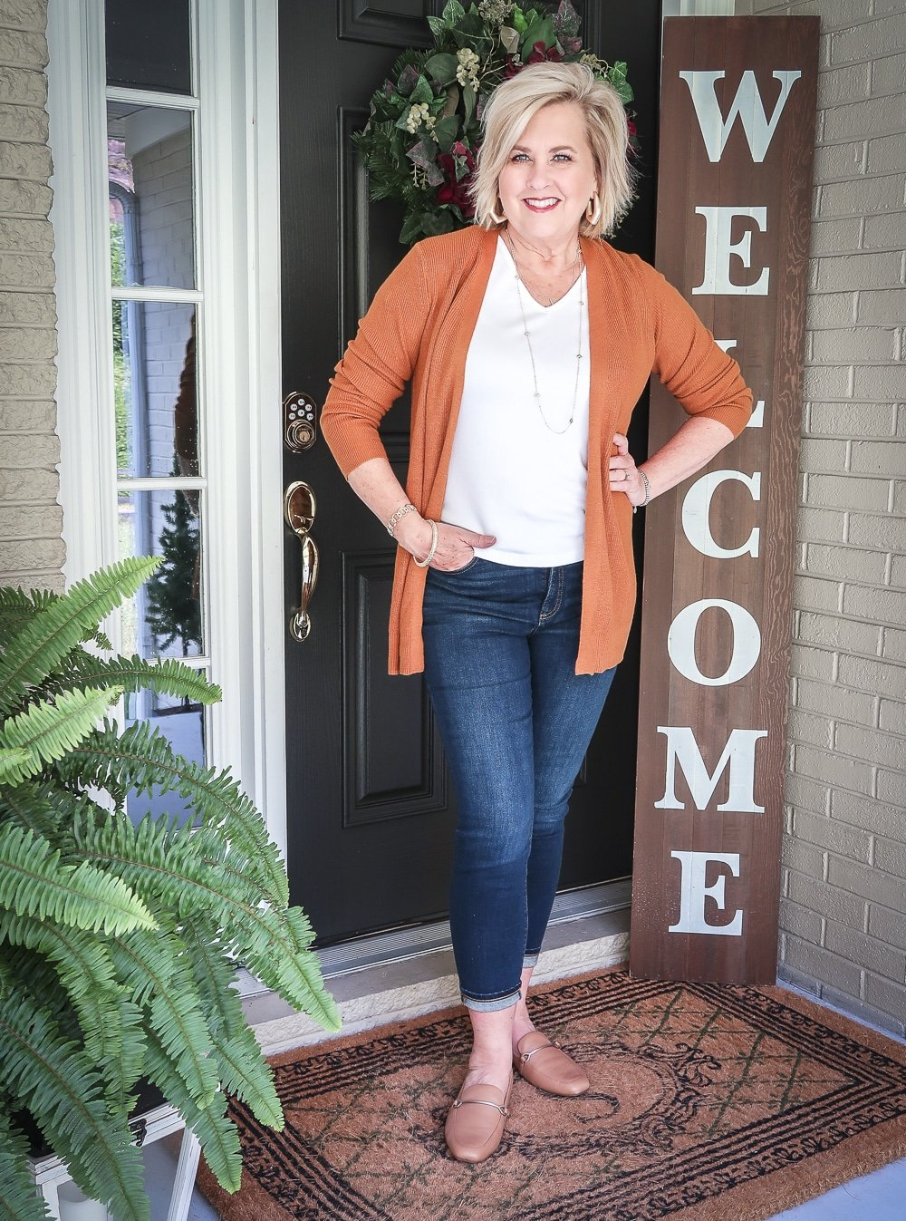 Fashion Blogger 50 Is Not Old is doing a Tuesday Try-On Session with Target and styling a rust cardigan with a white v-neck tee shirt