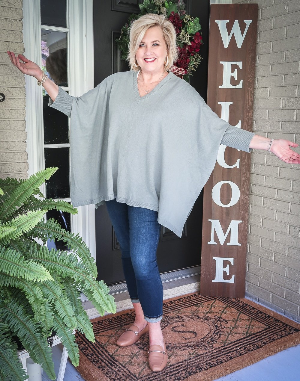 Fashion Blogger 50 Is Not Old is doing a Tuesday Try-On Session with Target and styling a marble green poncho, a white v-neck tee shirt, and dark jeans from Chico's