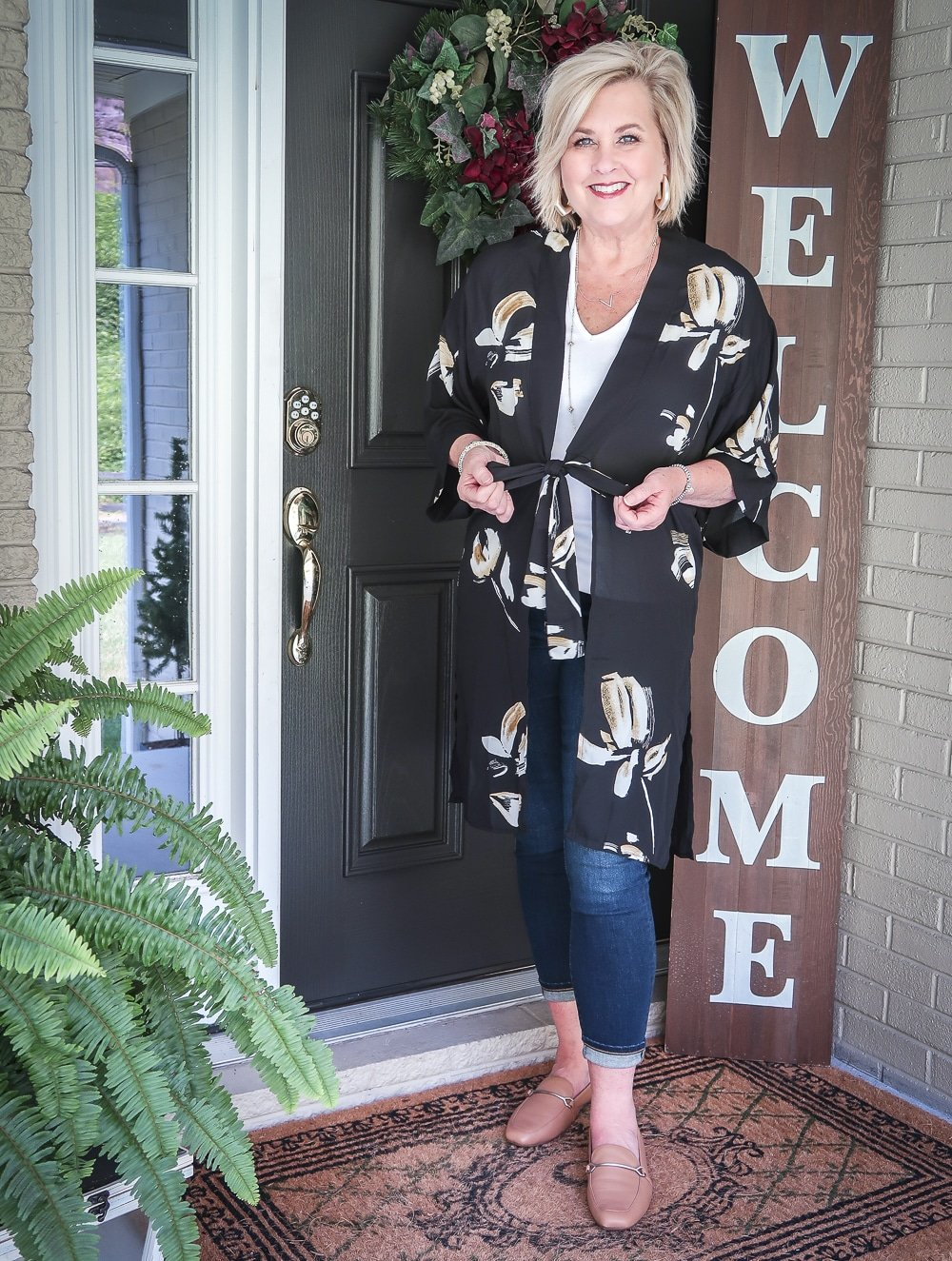 Fashion Blogger 50 Is Not Old is doing a Tuesday Try-On Session with Target and styling a black floral kimono with a white v-neck tee shirt