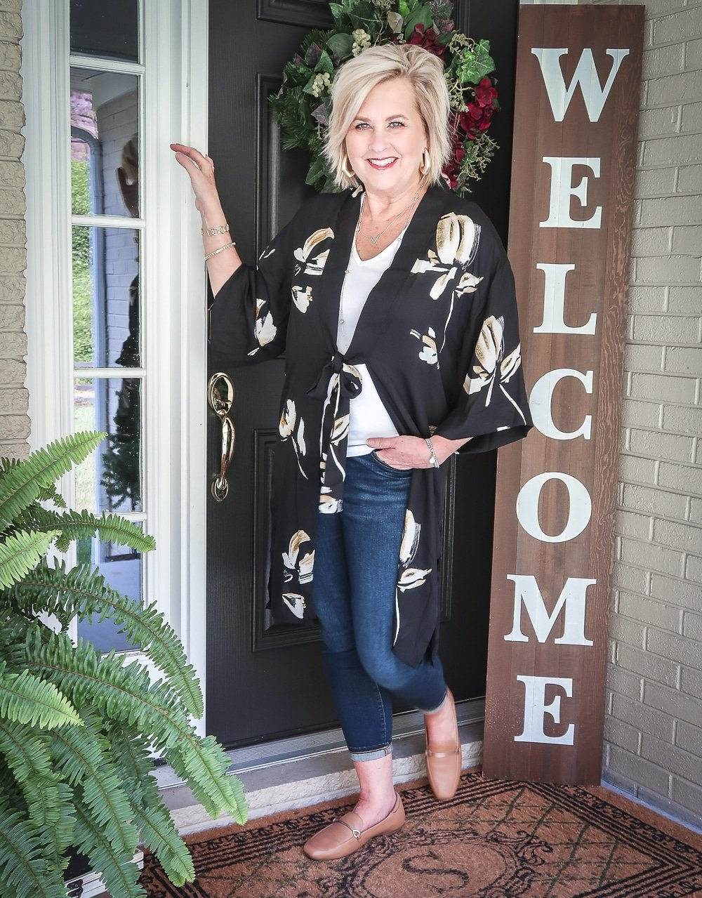 Fashion Blogger 50 Is Not Old is doing a Tuesday Try-On Session with Target and styling a black floral kimono, a white v-neck tee shirt, and dark jeans from Chico's