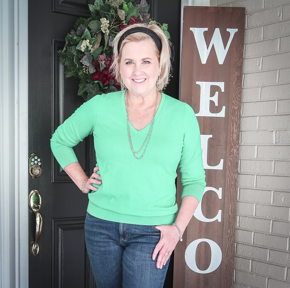 Fashion Blogger 50 Is Not Old is wearing a vibrant green v-neck sweater