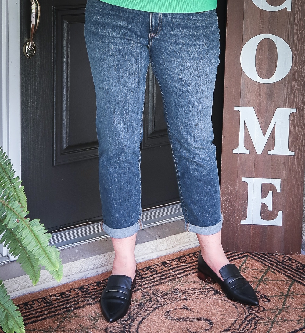 Fashion Blogger 50 Is Not Old is wearing girlfriend crop jeans, and black pointy loafers