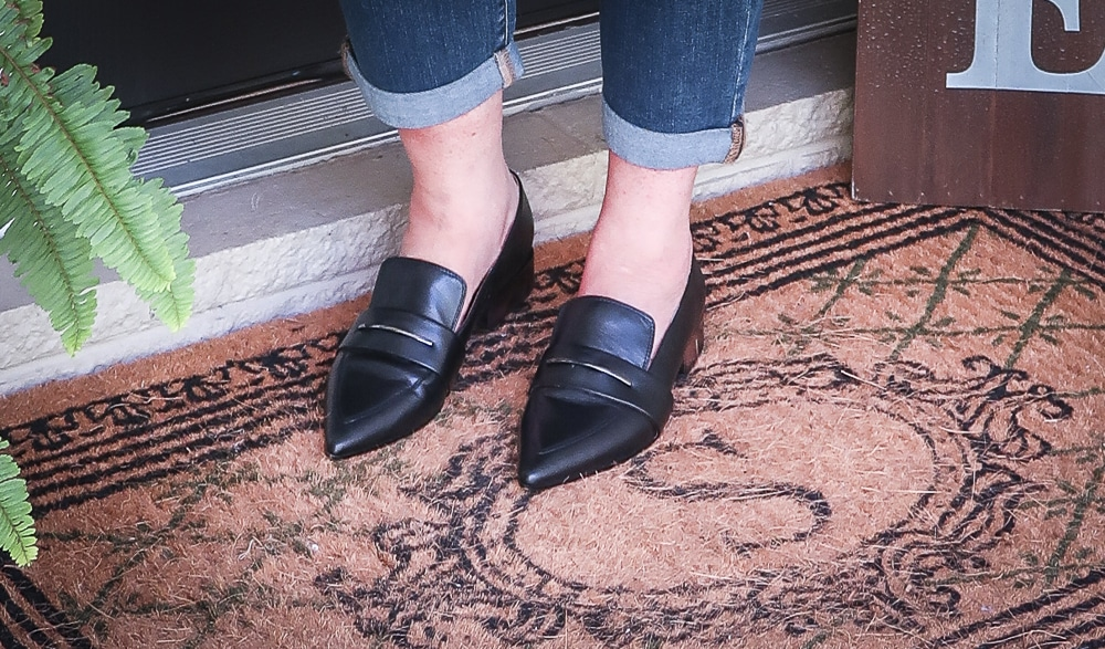 Fashion Blogger 50 Is Not Old is wearing black pointy loafers