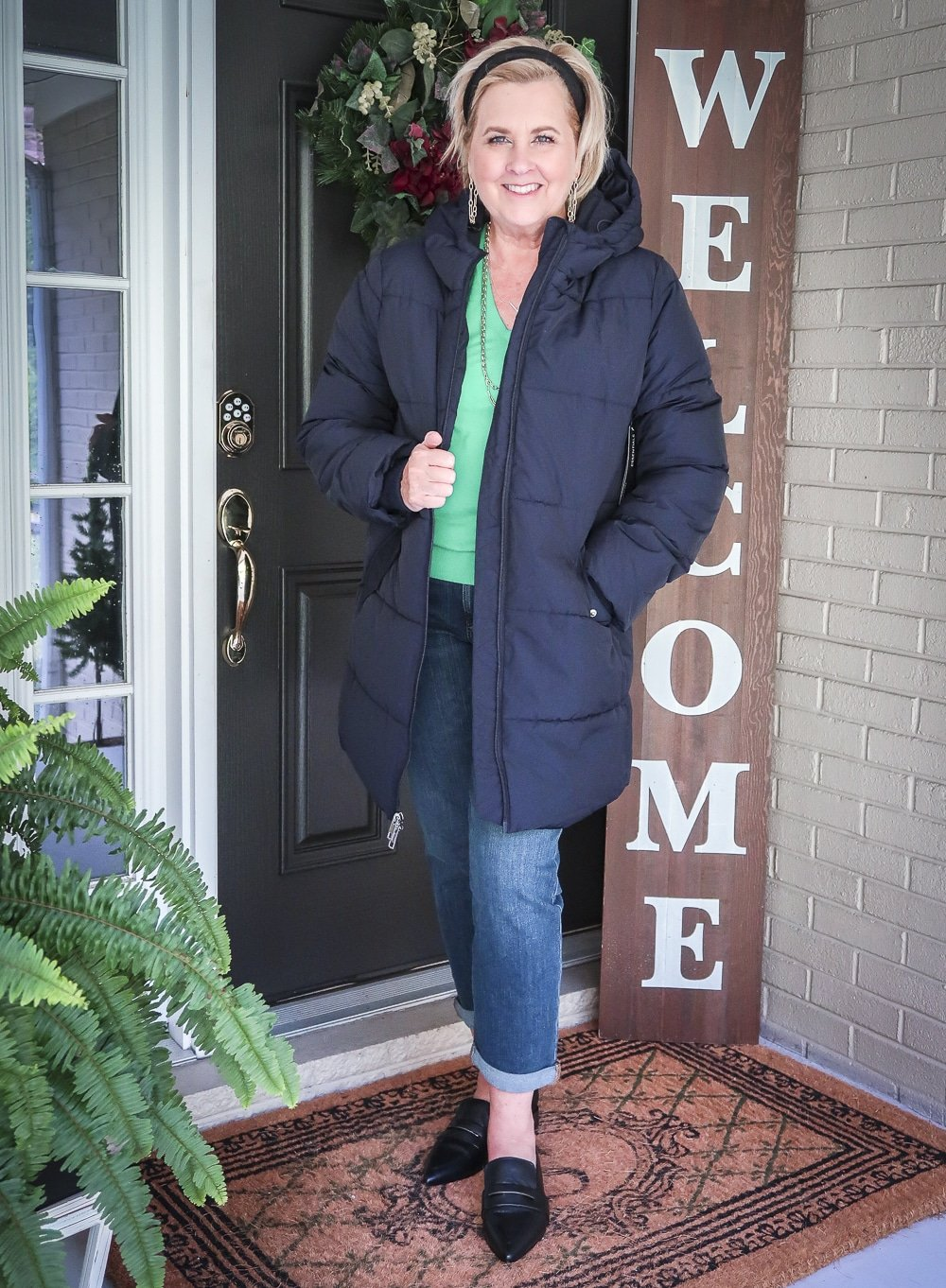 Fashion Blogger 50 Is Not Old is wearing a puffer coat with crop jeans and pointed-toe loafers