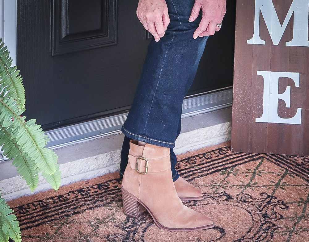 Fashion Blogger 50 Is Not Old is wearing bootcut jeans and ankle boots for fall